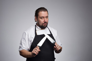 Cook holding a sharp knife.