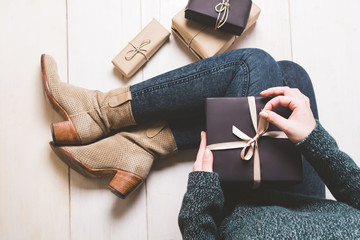 Overhead view of fashionable woman with wrapped Christmas gifts