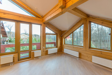 Large empty room in a wooden cottage