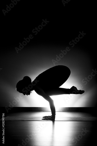 """Woman doing yoga crow pose silhouette black and white ..."