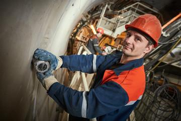 underground metro railway builder at tunnel construction work