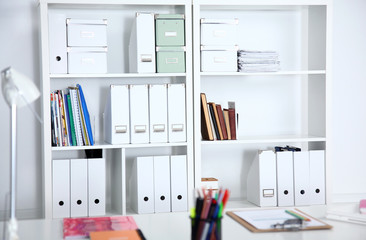 File folders, standing on the shelves at office.