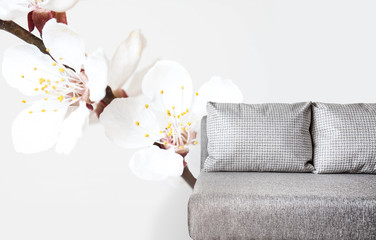Floral motif wallpaper and modern couch fragment, Interior decor mockup