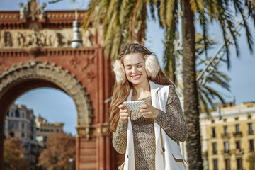 happy elegant woman in Barcelona, Spain writing sms