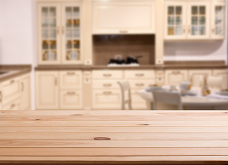 top of wooden table and kitchen space