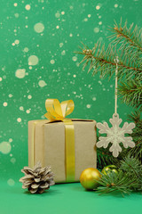 Green background for Christmas card with a gift