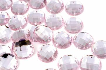 Pink rhinestone on white background