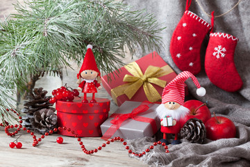 Christmas gifts in boxes and gnome