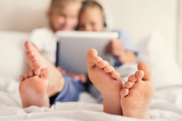 Children playing with gadget