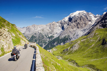 Close view on motorbike on the famous road in mountains Alps Passo Stelvio. Favourite place for all bike riders