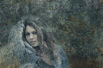 Double exposure of attractive teenage girl hiding behind dark grunge texture.