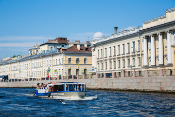 Tourist boat on the river Neva in St. Petersburg