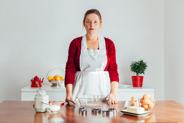 Woman is ready for making cake