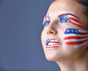 Girl with USA makeup on grey background