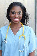 Smiling healthcare worker woman with stethoscope