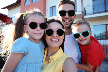 Family with kids taking selfie near car outdoor