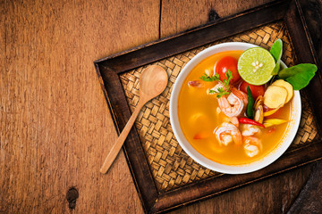 Tom yam kong or Tom yum, Tom yam is a spicy clear soup typical i