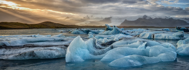Icebergs in Iceland's Jökulsarlon Glacial Lagoon at Sunset