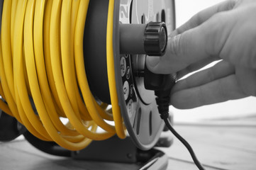 Abstract image of a man connecting plug to an extension lead