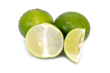 Lemon or lime fruit with half cross section and partial section