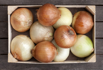 Wooden box of fresh onions