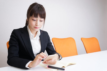 Young woman reading something at office