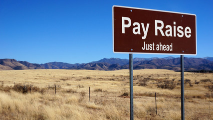 Pay Raise brown road sign