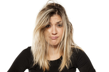 desperate young woman with messy hair