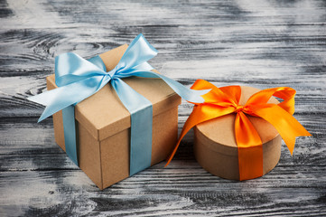 blue and orange bow with handmade present boxes