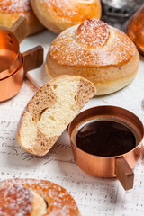 Buns with chocolate, cocoa and coffee. Breakfast. Copper Cezve with black coffee