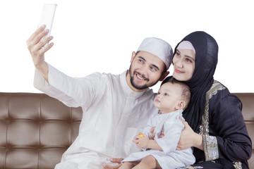 Arabian family taking selfie picture