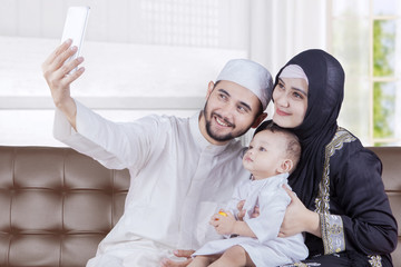 Arabian parents and son take selfie photo