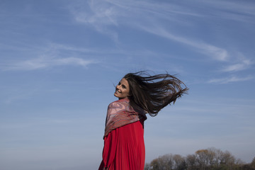 Beautiful girl with long hair on the wind