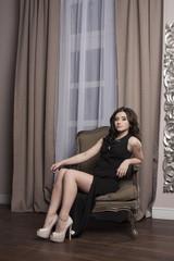 Beautiful girl in expensive black dress