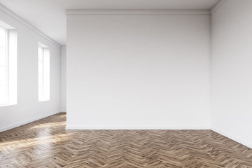 Empty room with white walls and wooden floor
