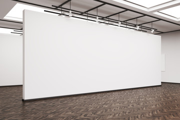 Side view of a large blank wall in an art gallery with dark wood