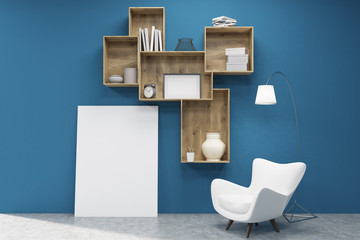 Dark wood shelves, a poster and an armchair near a blue wall