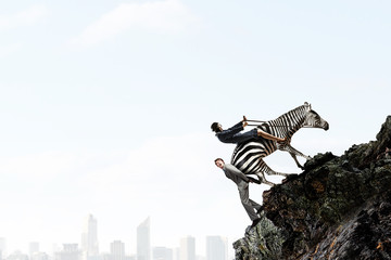 Fototapete - Businesswoman ride zebra . Mixed media