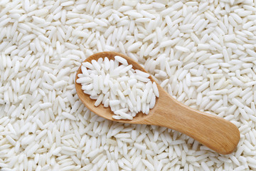 Organic white rice in wooden spoon, glutinous rice or sticky ric