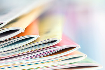 Close up edge of colorful magazine stacking