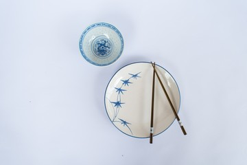Plates and bowls, chopsticks prepared for the Chinese people.