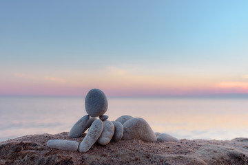 Figurine on seashore