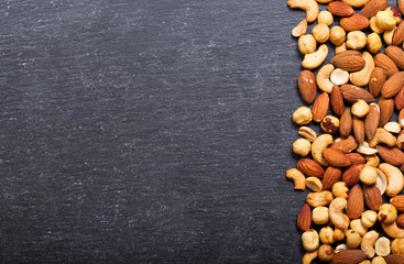 mixed nuts on dark background