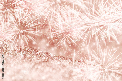 Silver And Rose Gold Fireworks Bokeh On Gliter Paper At New Year Copy Space