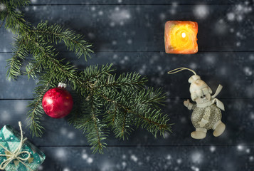 Christmas composition with pine twigs, toys and gifts.
