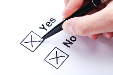 Check boxes yes and no on white paper