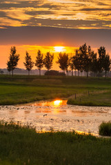 Amazing beautiful sunset along Dutch dikes