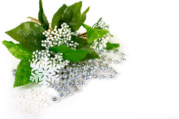 Christmas bouquet of white flowers, snowflakes and silver beads on a white background