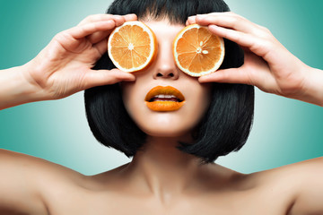 Girl with orange. Bright makeup, Ombre.