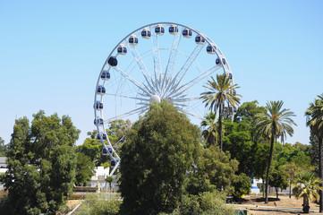 Large ferris wheel against blue sky
